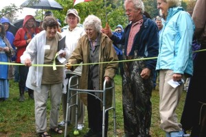 Elaine Beals with son Whitney cutting ribbon at dedication of Beals Preserve, September 2009
